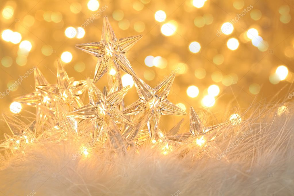 Star holiday lights with gold sparkle background — Stock Photo #8017527