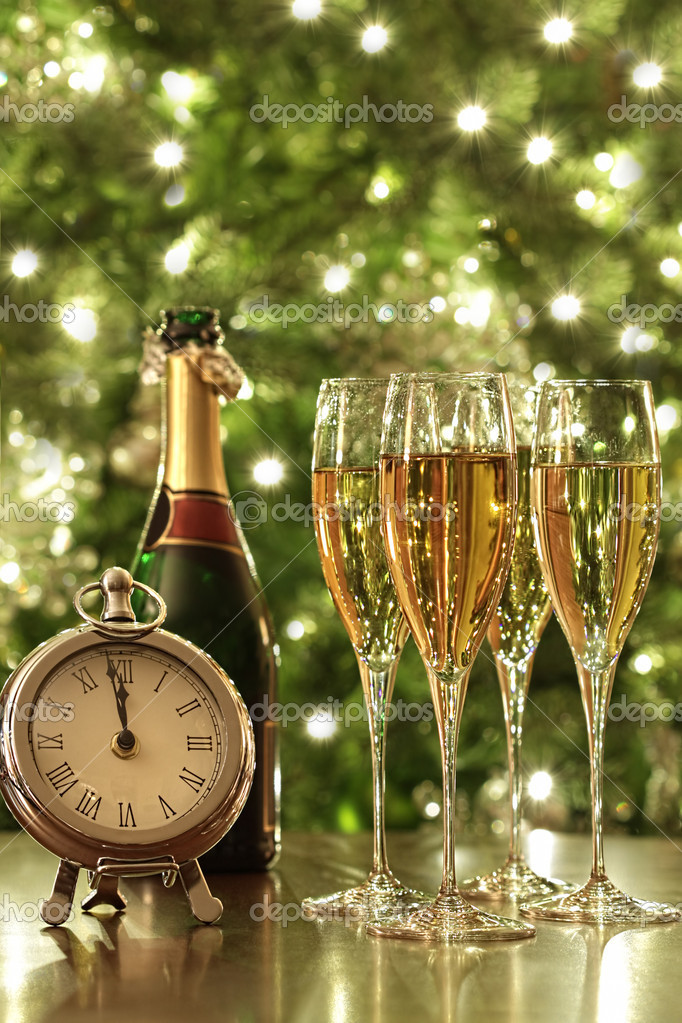 Glasses of champagne for the countdown to New Years  Stock Photo #8017539