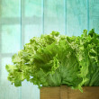 Lettuce in wooden box against grunge background - Stock Photo