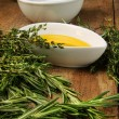 Assorted fresh herbs with olive oil — Stock Photo