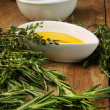 Assorted fresh herbs with olive oil - Stock Photo