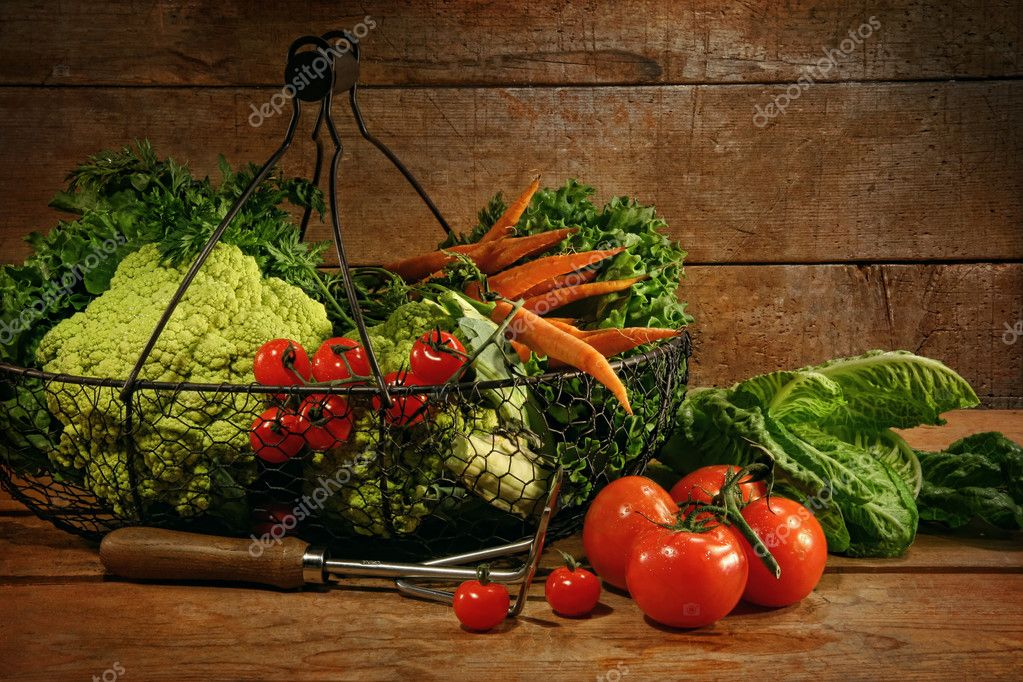 Freshly picked vegetables in metal basket on wooden table — Stock Photo #8557343