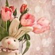 Toy rabbit with tulips for Easter - Stockfoto