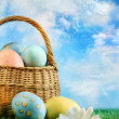 Basket of Easter eggs with a painterly effect — Stock Photo