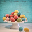 Sparkly color eggs and tulips for Easter — Stock Photo