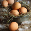 Fresh brown eggs on wood background - Stock Photo