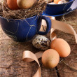 Easter eggs in blue cup with ribbons — Stock Photo