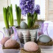 Royalty-Free Stock Photo: Purple hyacinths and easter eggs on table