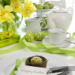 Place setting with card for easter brunch - Stock Photo