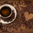 Heart shape from coffee beans on wood - Stock Photo