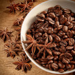 Bowl of coffee beans and spice - Stock Photo