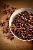 Bowl of coffee beans and spice — Stock Photo