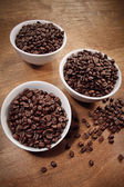 Coffee in white bowls on wood — Stock Photo