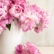 Pink peonies in vase - Stock Photo