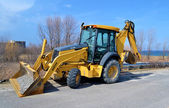 Backhoe on street. — Stock Photo
