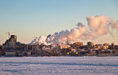 Heat Thermal station is on the shore of the frozen of the river — Stock Photo