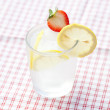 Stock Photo: Cocktail with ice, lemon and strawberry