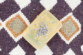Lavender and soap on ethnic mat — Stock Photo