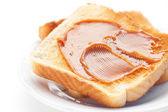 Toast with caramel isolated on white — Stock Photo