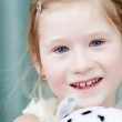 Portrait of a beautiful little girl with a toy dog — Stock Photo #8476332