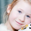 Portrait of a beautiful little girl with a toy dog — Stock Photo #8476340