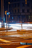 Strip from passing cars and traffic lights at night street — Stock Photo