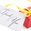 Red gift box and thank you card  isolated on white — Stock Photo