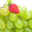 Bunch of white grapes and strawberries isolated on white - Stock Photo