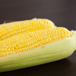 Corn lying on a wooden table — Stock Photo