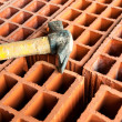 Stock Photo: Hollow brick with hammer