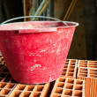 Stock Photo: Bucket on hollow bricks