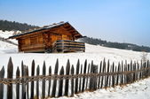 Old winter cottage with fence — Stock Photo