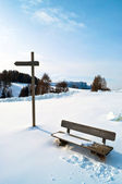 Wooden Winter bench with mark trial — Stock Photo
