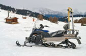 Snowmobile on alps in winter time — Stock Photo