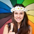 Young woman in chamomile wreath with colorful umbrella — Stock Photo #10076449