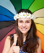 Young woman in chamomile wreath with colorful umbrella — Stock Photo