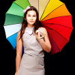 Portrait of young woman with colorful umbrella — Stock Photo