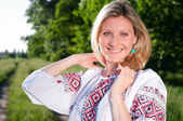 Smiling ukrainian woman outdoors on the meadow — Stock Photo