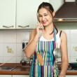 Housewife talking phone on the kitchen — Stock Photo