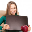 Beautiful woman office worker with laptop and apple — Stock Photo