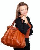 Jonge lachende vrouw met handtas — Stockfoto