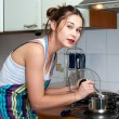 Young beautiful housewife cooking on the kitchen — Stock Photo