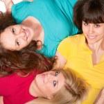 Three beautiful brunette, blonde and redhead girls lying down — Stock Photo #8626233