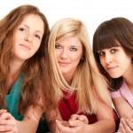 Three beautiful brunette, blonde and redhead girls lying down — Stock Photo #8626236