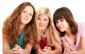Three beautiful brunette, blonde and redhead girls lying down — Stock Photo