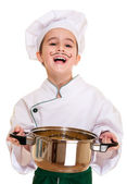 Laughing cookee boy in hood with pot in hands — Stock Photo