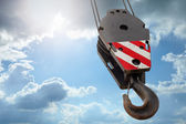 Crane hook on a blue sky — Stockfoto