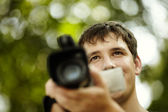 Young man with camcorder — Stock Photo
