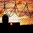 Sunset over prison yard - Stock Photo