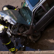 Firemen checking crashed car — Foto Stock